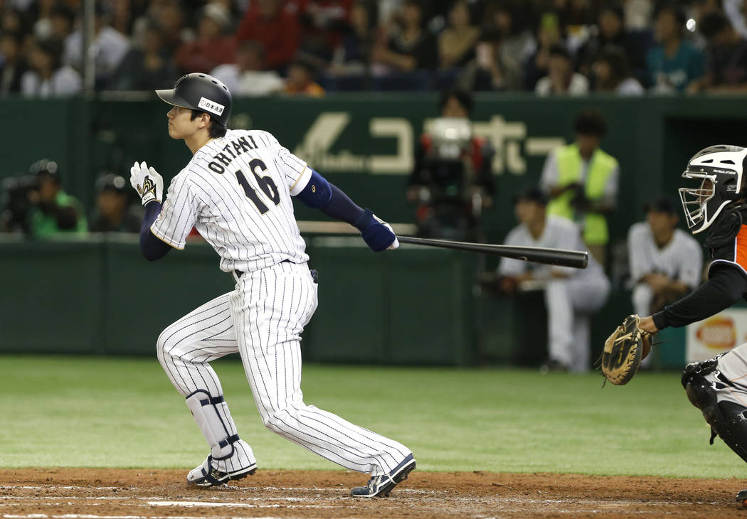 In this Nov. 12, 2016, file photo, Japan's designated hitter Shohei Ohtani watches the flight of his solo home run off Netherlands' pitcher Jair Jurrjens in the fifth inning of their international ...