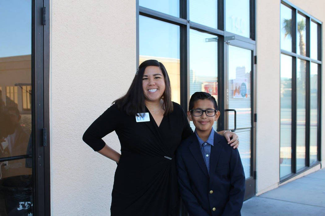 Erica Mosca, founder and executive director of Leaders in Training, poses with a student at an open house for the organization, which began in 2012 and aims to help students become empowered in th ...