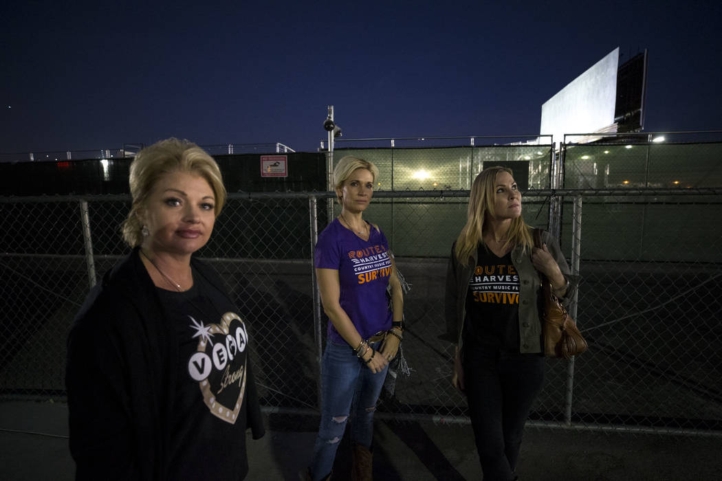 Route 91 Harvest survivors Tina Cartwright, from left, Michelle McGinn and Kim Yeazel visit the Las Vegas Village festival grounds, Monday, Dec. 18, 2017, the site of the Oct, 1 shooting. The frie ...