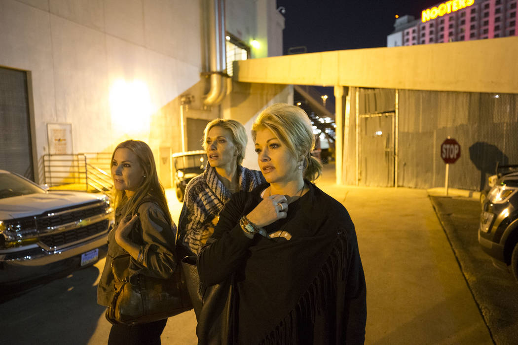 Route 91 Harvest survivors Kim Yeazel, from left, Michelle McGinn and Tina Cartwright visited the Las Vegas Village festival grounds, Monday, Dec. 18, 2017, the site of the Oct, 1 shooting. The fr ...