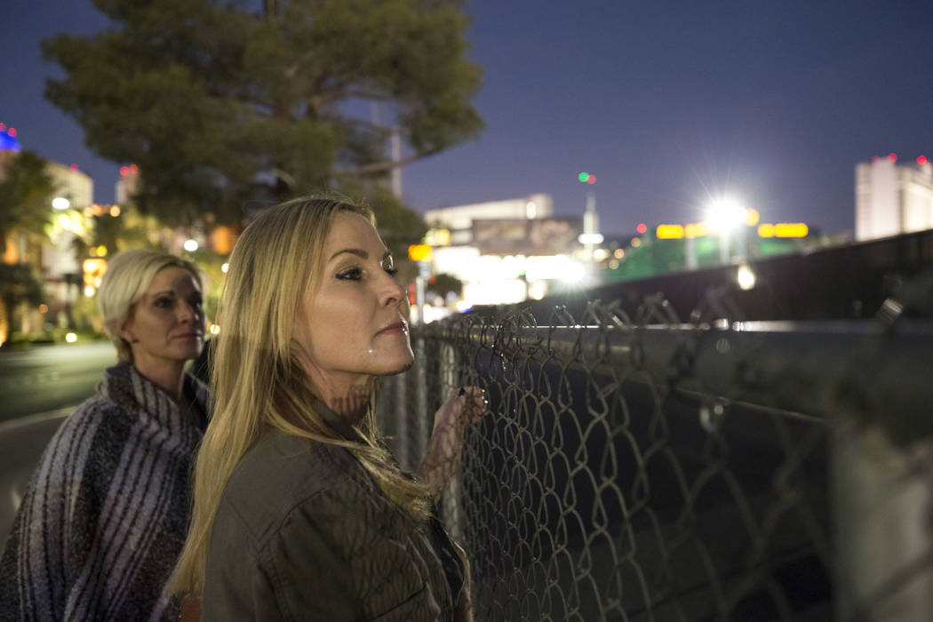 Route 91 Harvest survivors Michelle McGinn, left, and Kim Yeazel visit the Las Vegas Village festival grounds, Monday, Dec. 18, 2017, the site of the Oct. 1 shooting. They retraced their path back ...
