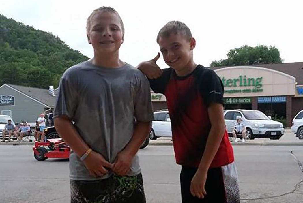 Brothers Hunter Otteson, left, and Chase Otteson, right, pose in an undated photo. (GoFundMe)