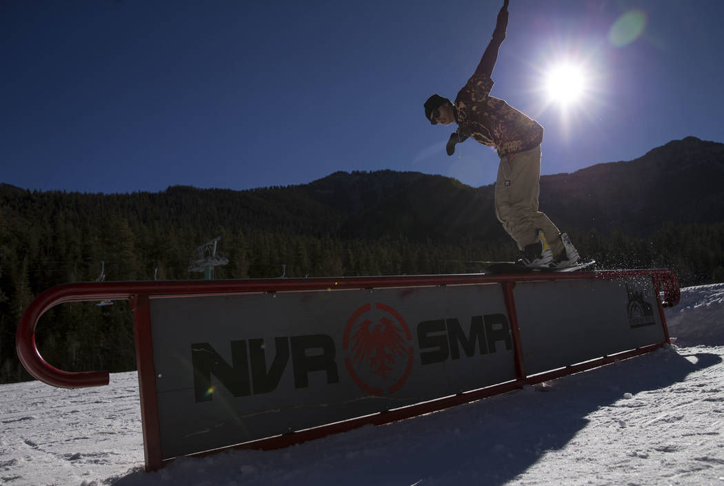 Snowboarder Curren Weber, 20, hits a rail on the bunny hill on Friday afternoon, Dec. 8, 2017, at Lee Canyon opening day. Richard Brian Las Vegas Review-Journal @vegasphotograph