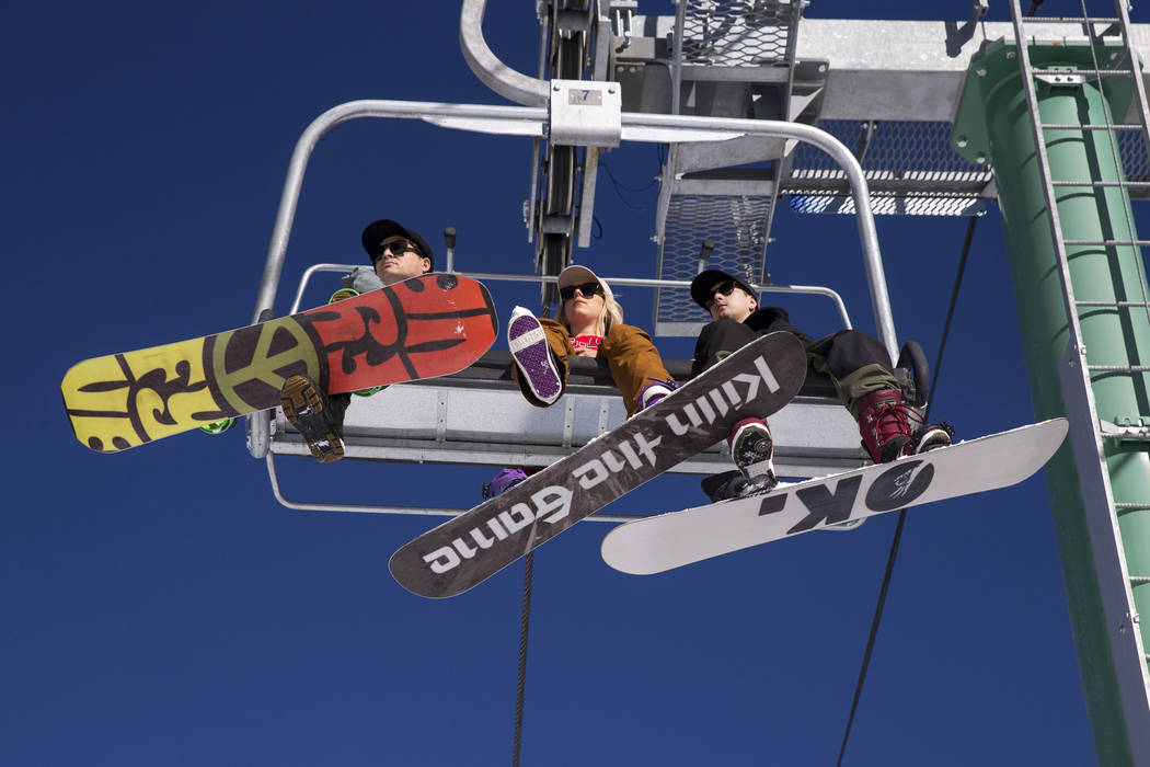 Snowboarders ride the Rabbit Peak ski lift on Friday afternoon, Dec. 8, 2017, at  Lee Canyon opening day. Richard Brian Las Vegas Review-Journal @vegasphotograph
