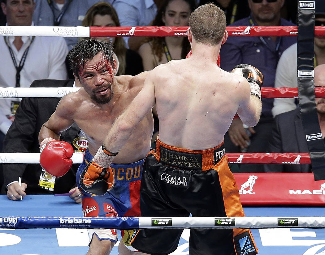 Manny Pacquiao of the Philippines, left, lands a left, to Jeff Horn of Australia, during their WBO World Welterweight title fight in Brisbane, Australia, Sunday, July 2, 2017. (AP Photo/Tertius Pi ...
