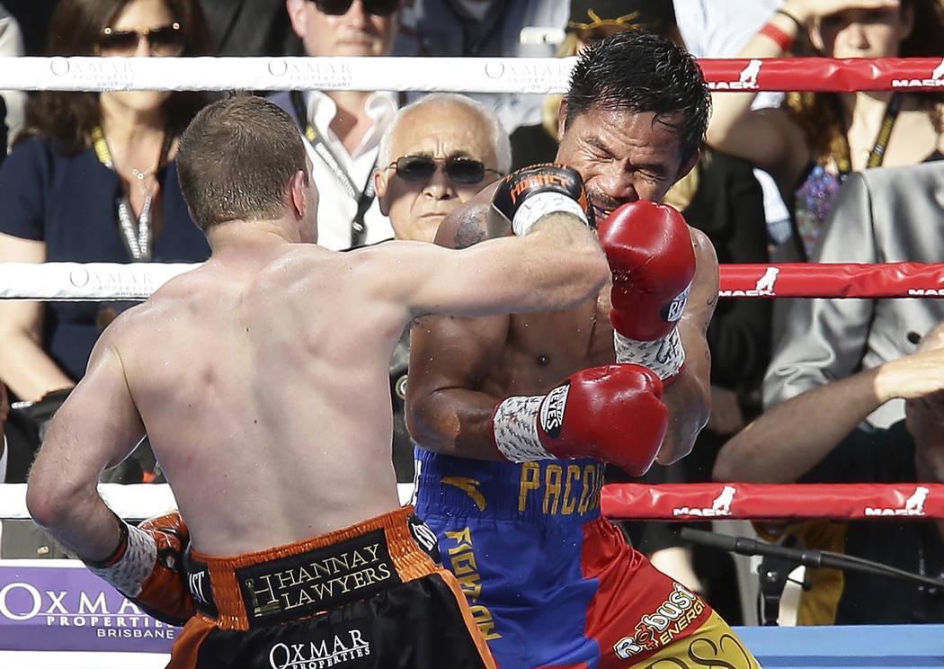 Jeff Horn of Australia, left,  lands a right to Manny Pacquiao of the Philippines during their WBO World Welterweight title fight in Brisbane, Australia, Sunday, July 2, 2017. (AP Photo/Tertius Pi ...