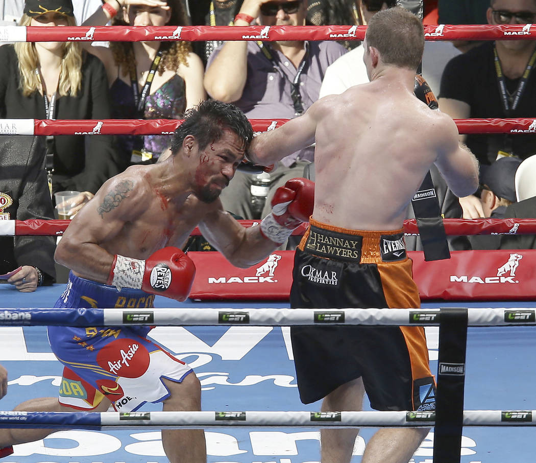 Jeff Horn of Australia, right,  lands a left to Manny Pacquiao of the Philippines during their WBO World Welterweight title fight in Brisbane, Australia, Sunday, July 2, 2017. (AP Photo/Tertius Pi ...