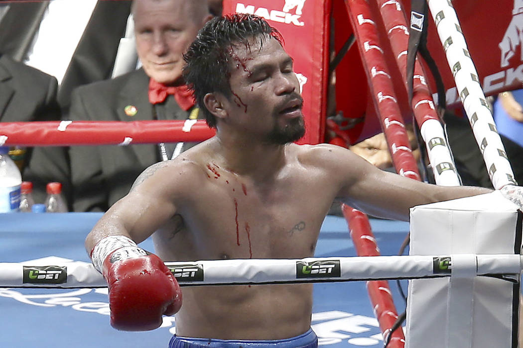 FILE - In this July 23, 2017, file photo, Manny Pacquiao, of the Philippines, reacts after his loss to Jeff Horn, of Australia, in a WBO World Welterweight title fight in Brisbane, Australia. Pacq ...