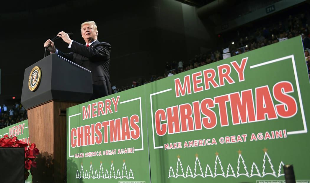 President Donald Trump takes to the stage at a campaign-style rally at the Pensacola Bay Center, in Pensacola, Fla., Friday, Dec. 8, 2017.  (AP Photo/Susan Walsh)