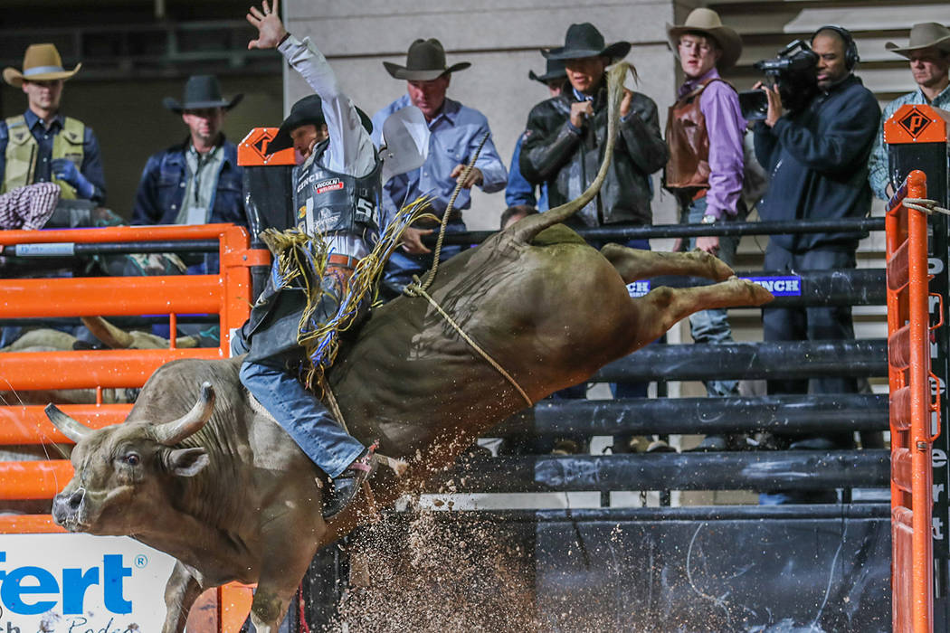 J.W. Harris rides Chocolate Thunder to a winning score of 86 points Thursday afternoon during the Cinch Boyd Gaming Chute-Out at Orleans Arena. The three-day rodeo, featuring all seven events, wra ...