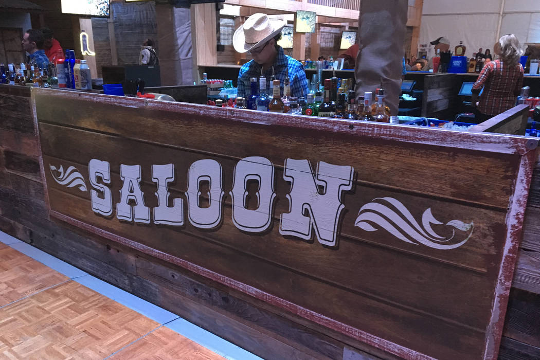 The Saloon is just one quaint aspect of the nightly viewing party at the Downtown Las Vegas Events Center. The room is split in half, with a 25-foot video screen facing out each direction, and a b ...