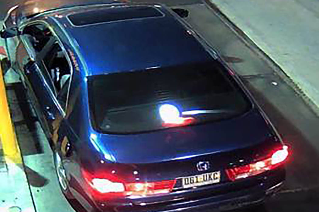 The four-door dark blue 2003 Honda Accord has a sunroof, lightly tinted windows and a gas tank flap doesn't close. The Nevada license plate is 061UKC. (Henderson Police Department)