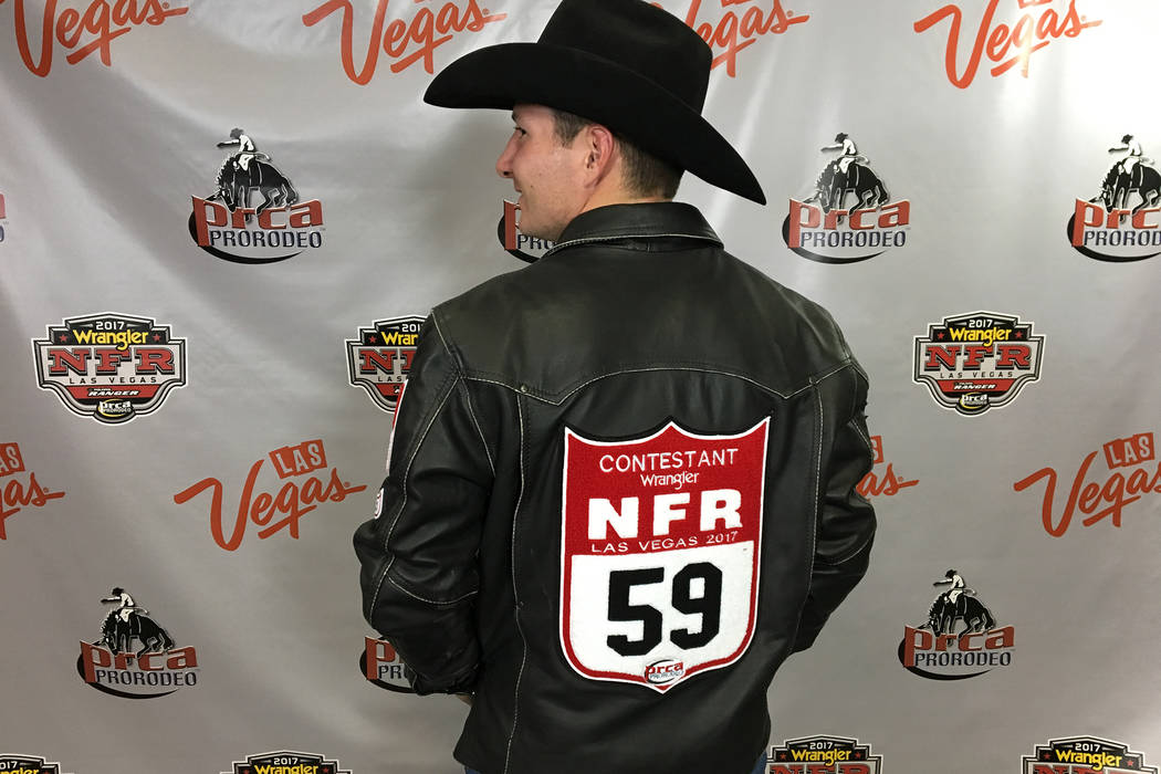 Bareback rider Bill Tutor displays his 59 back number on Thursday at the Wrangler National Finals Rodeo, following an opening-night tribute to victims of the Oct. 1 shooting. Based on his season e ...