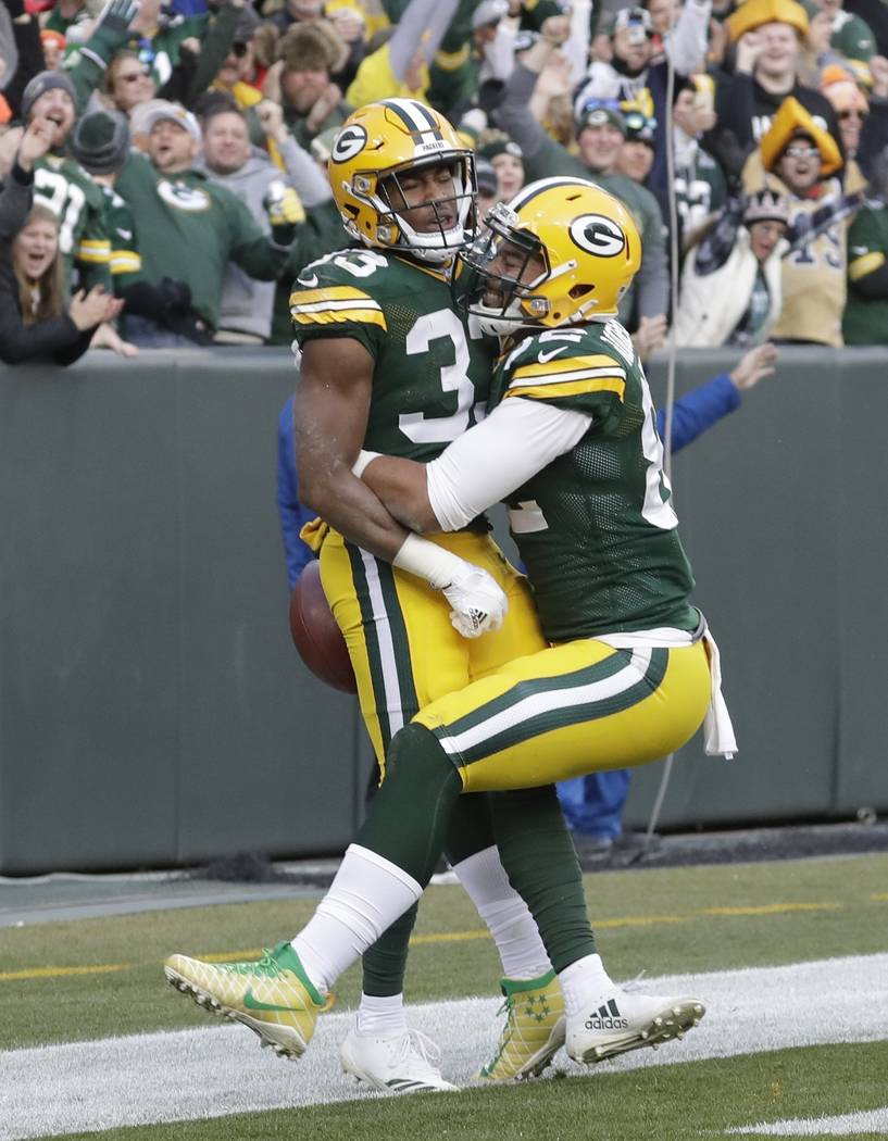 Green Bay Packers' Aaron Jones celebrates his touchdown run during overtime of an NFL football game against the Tampa Bay Buccaneers Sunday, Dec. 3, 2017, in Green Bay, Wis. The Packers won 26-20. ...