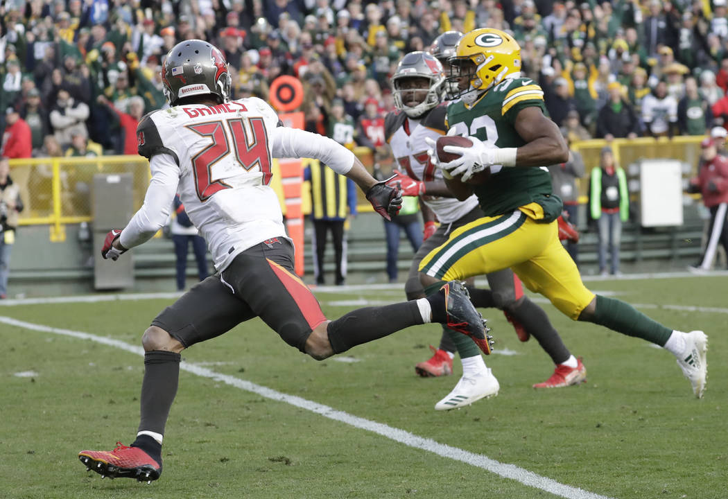 Green Bay Packers' Aaron Jones runs for a touchdown during overtime of an NFL football game against the Tampa Bay Buccaneers Sunday, Dec. 3, 2017, in Green Bay, Wis. The Packers won 26-20. (AP Pho ...