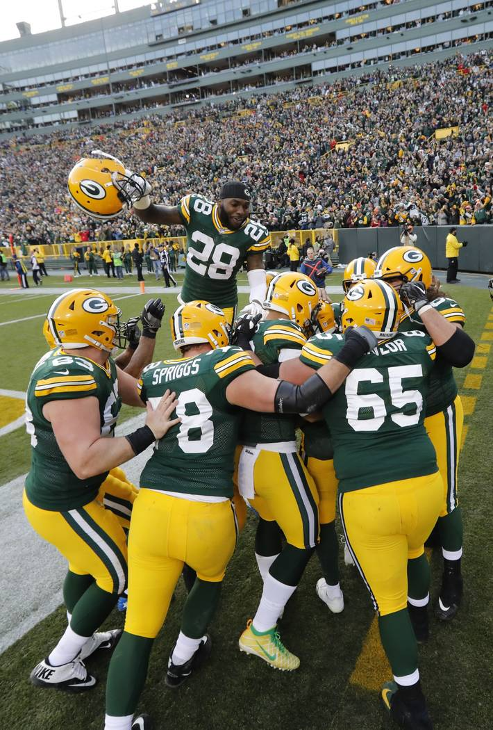 Green Bay Packers' Aaron Jones celebrates his touchdown run with teammates during overtime of an NFL football game against the Tampa Bay Buccaneers Sunday, Dec. 3, 2017, in Green Bay, Wis. The Pac ...
