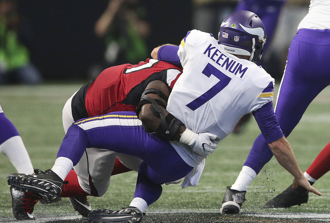 Atlanta Falcons defensive tackle Grady Jarrett (97) sacks Minnesota Vikings quarterback Case Keenum (7) during the first half of an NFL football game, Sunday, Dec. 3, 2017, in Atlanta. (AP Photo/J ...
