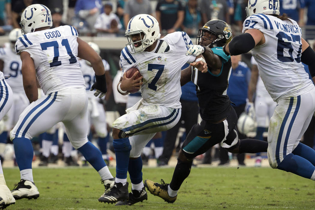 Indianapolis Colts quarterback Jacoby Brissett (7) is pressured by Jacksonville Jaguars defensive end Yannick Ngakoue (91) during the second half of an NFL football game, Sunday, Dec. 3, 2017, in  ...