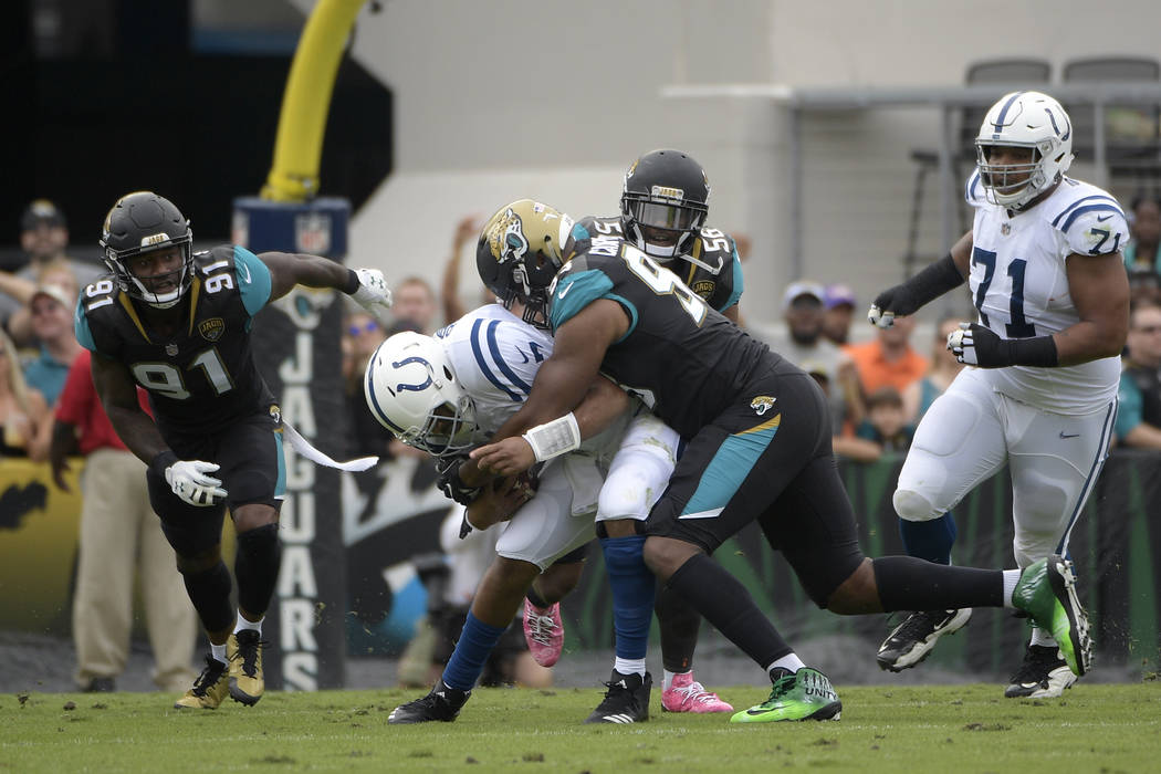 Jacksonville Jaguars defensive end Calais Campbell (93) sacks Indianapolis Colts quarterback Jacoby Brissett (7) during the first half of an NFL football game Sunday, Dec. 3, 2017, in Jacksonville ...