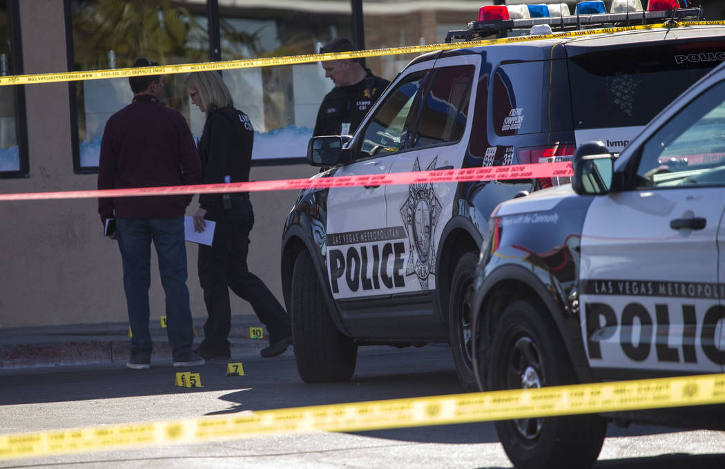 Crime scene investigators and detectives investigate a shooting incident at Terrible Herbst convenience store at the intersection of North Decatur Blvd. and Vegas Drive on Saturday, Dec. 9. 2017,  ...