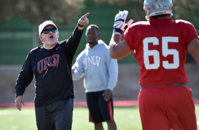 UNLV defensive coordinator Kent Baer calls to a player during spring practice at Rebel Field at UNLV on Monday, April 13, 2015, in Las Vegas. (David Becker/Las Vegas Review-Journal)
