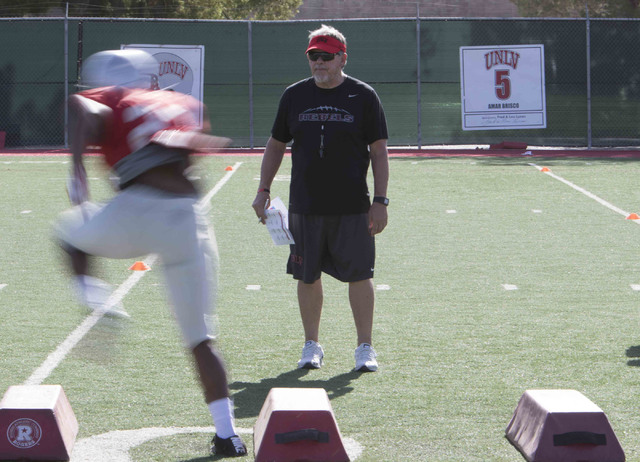 UNLV's defensive coordinator Kent Baer, right, observes a player on a drill during team practice at the Rebel Park field at UNLV on Wednesday, Aug. 10, 2016. Richard Brian/Las Vegas Review-Journal ...