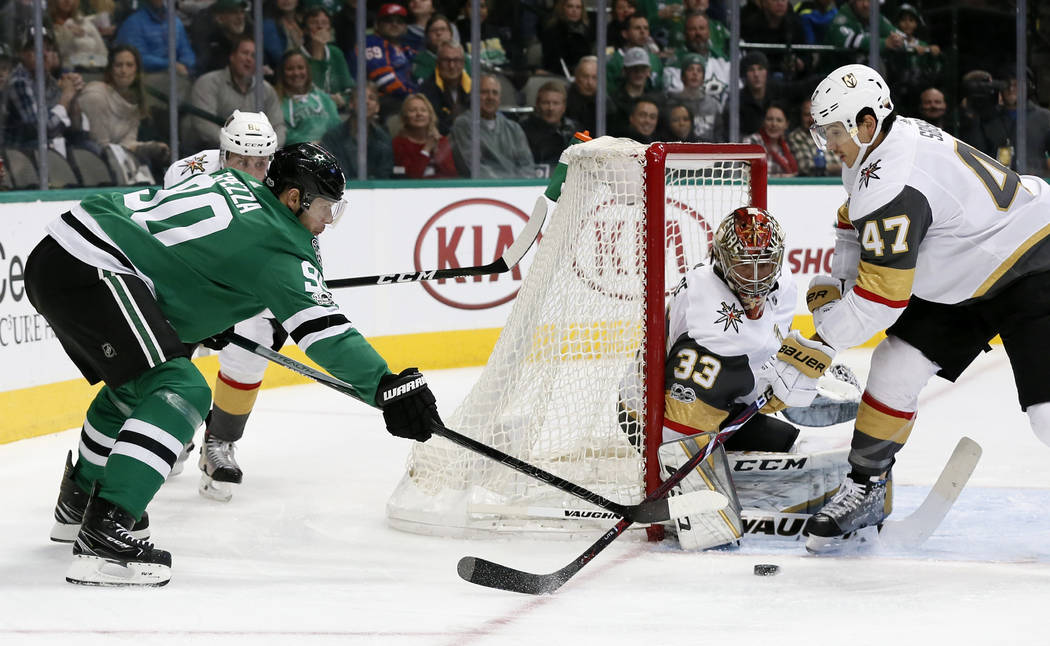 Dallas Stars' Jason Spezza (90) pressures the net as Vegas Golden Knights' Luca Sbisa (47) helps goalie Maxime Lagace defend during the first period of an NHL hockey game, Saturday, Dec. 9, 2017,  ...