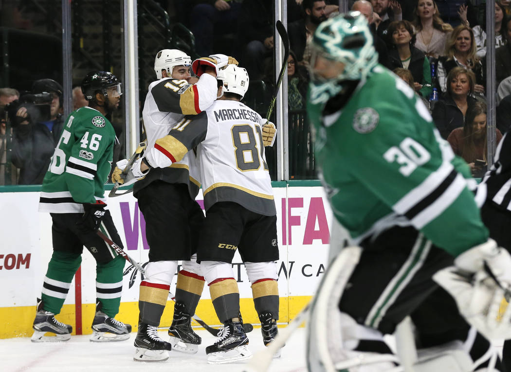 Dallas Stars' Gemel Smith (46) and goalie Ben Bishop (30) skate away as Vegas Golden Knights' Reilly Smith (19) and Jonathan Marchessault (81) celebrate a goal by Smith during the second period of ...