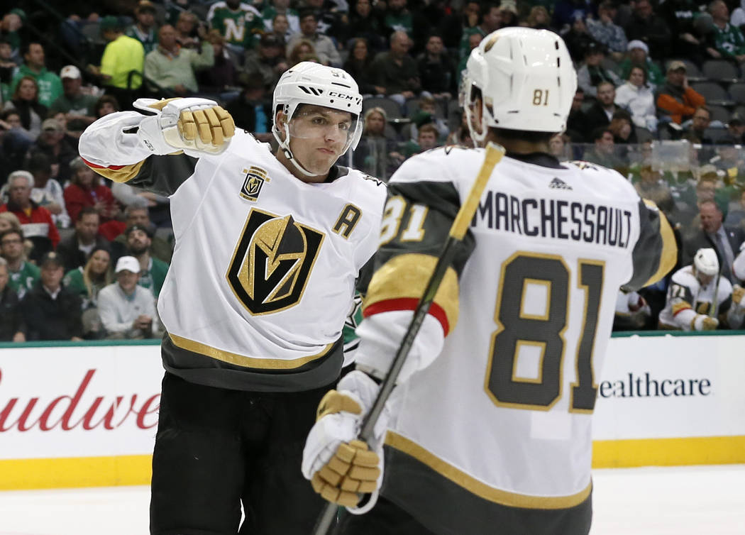 Vegas Golden Knights' David Perron (57) and Jonathan Marchessault (81) celebrate a goal by Perron during the second period of an NHL hockey game against the Dallas Stars on Saturday, Dec. 9, 2017, ...