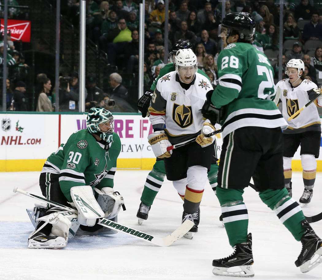 Dallas Stars goalie Ben Bishop (30) and defenseman Stephen Johns (28) watch as Vegas Golden Knights left wing James Neal (18) celebrates a goal scored by David Perron, not pictured in the second p ...