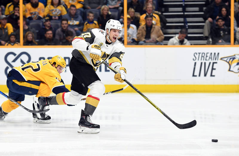 Dec 8, 2017; Nashville, TN, USA; Vegas Golden Knights defenseman Shea Theodore (27) passes the puck out of the defensive zone during the first period against the Nashville Predators at Bridgestone ...