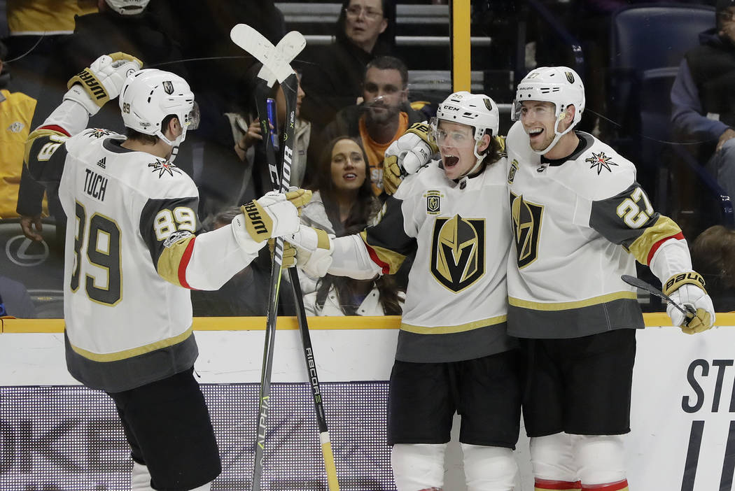 Vegas Golden Knights left wing Erik Haula, center, of Finland, celebrates with Alex Tuch (89) and Shea Theodore (27) after scoring the tying goal against the Nashville Predators in the final minut ...