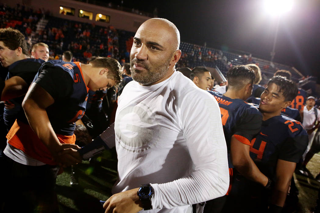 Bishop Gorman head coach Kenny Sanchez, center, shakes hands with players after their 34-7 win over De La Salle at Bishop Gorman High School on Saturday, Sept. 16, 2017, in Las Vegas.   Bridget Be ...