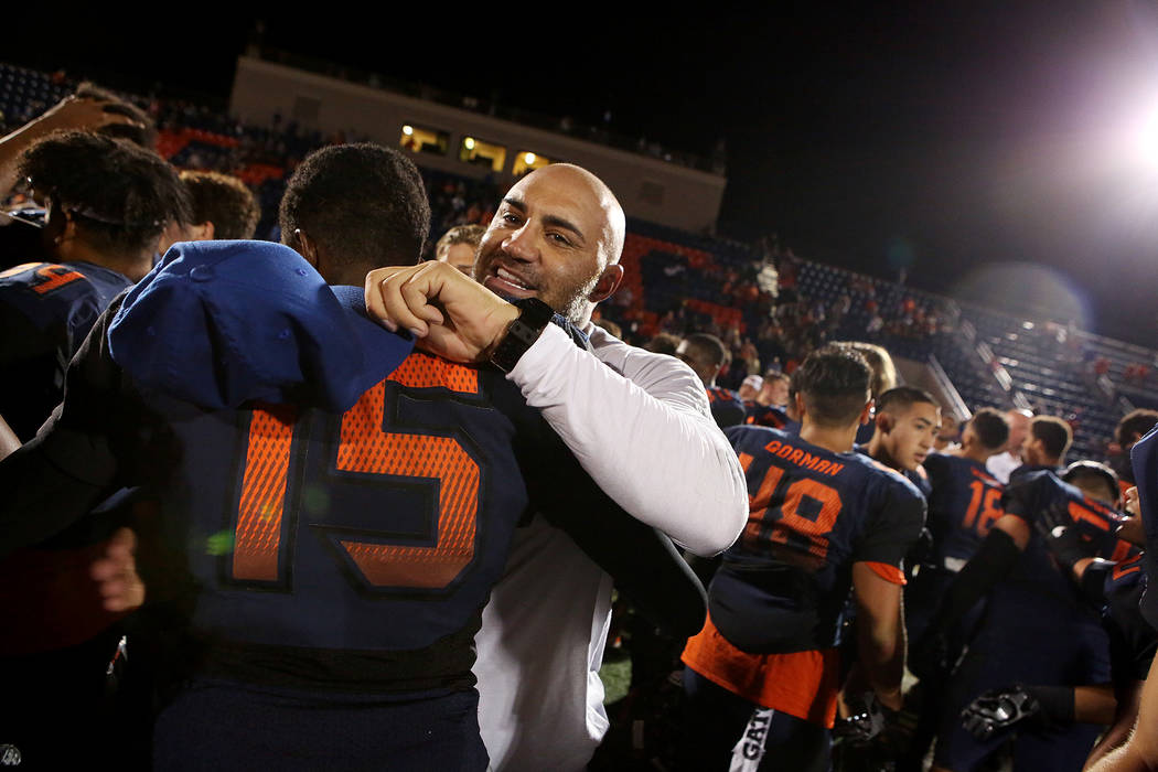 Bishop Gorman head coach Kenny Sanchez embraces Kyu Kelly (15) their 34-7 win over De La Salle at Bishop Gorman High School on Saturday, Sept. 16, 2017, in Las Vegas.   Bridget Bennett Las Vegas R ...