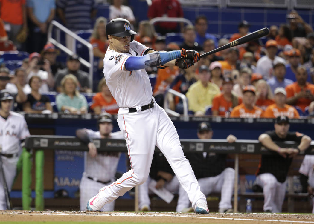 Miami Marlins' Giancarlo Stanton bats during the first inning of a baseball game against the Atlanta Braves, Sunday, Oct. 1, 2017, in Miami. (AP Photo/Lynne Sladky)