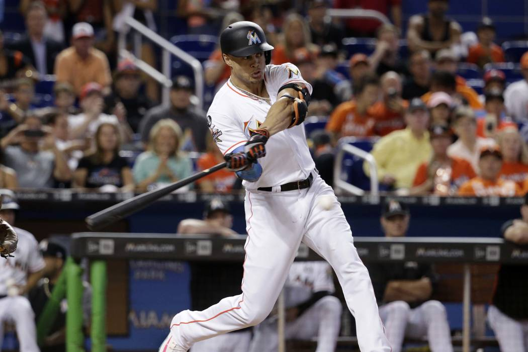 Miami Marlins' Giancarlo Stanton hits a single during the third inning of a baseball game against the Atlanta Braves, Sunday, Oct. 1, 2017, in Miami. (AP Photo/Lynne Sladky)