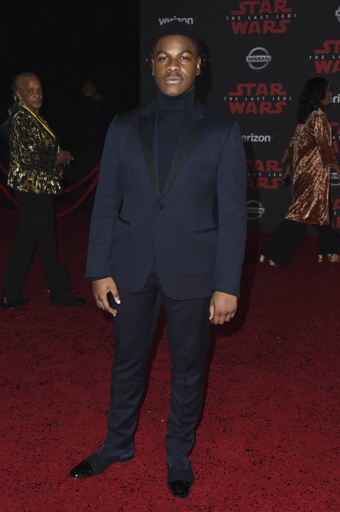 """John Boyega arrives at the Los Angeles premiere of """"Star Wars: The Last Jedi"""" at the Shrine Auditorium on Saturday, Dec. 9, 2017 in Los Angeles. (Photo by Jordan Strauss/Invision/AP)"""