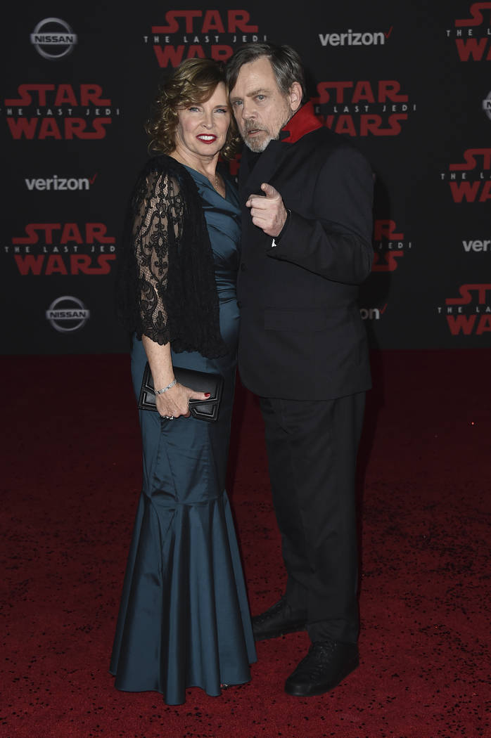 """Marilou Hamill, left, and Mark Hamill arrive at the Los Angeles premiere of """"Star Wars: The Last Jedi"""" at the Shrine Auditorium on Saturday, Dec. 9, 2017, in Los Angeles. (Photo  ..."""