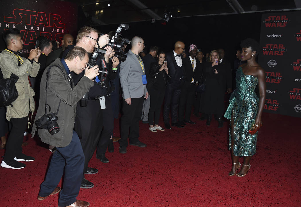 """Lupita Nyong'o arrives at the Los Angeles premiere of """"Star Wars: The Last Jedi"""" at the Shrine Auditorium on Saturday, Dec. 9, 2017 in Los Angeles. (Photo by Jordan Strauss/Invis ..."""