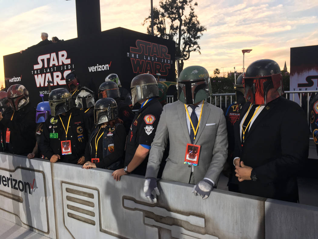 """Costumed fans line up outside the premiere of """"Star Wars: The Last Jedi"""" at the Shrine Auditorium in Los Angeles on Saturday, Dec. 9, 2017. (AP Photo/Nicole Evatt)"""