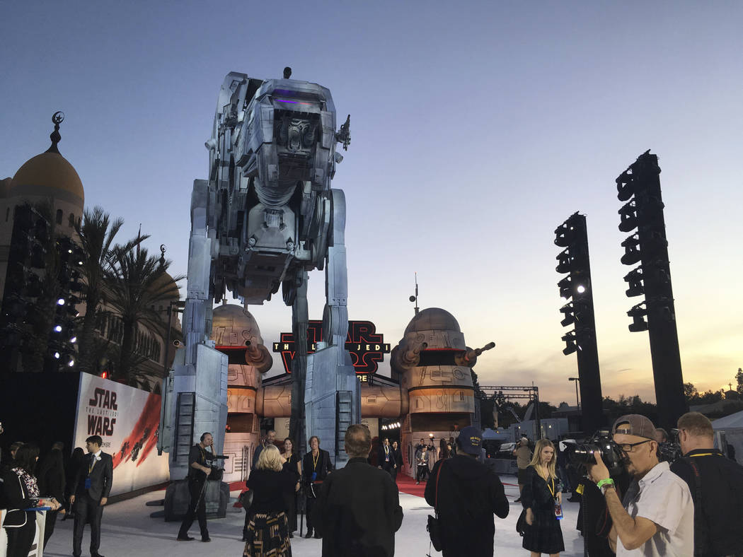 """A giant assault vehicle and gun turrets towers over the carpet as people arrive outside the premiere of """"Star Wars: The Last Jedi"""" at the Shrine Auditorium in Los Angeles, on Sat ..."""