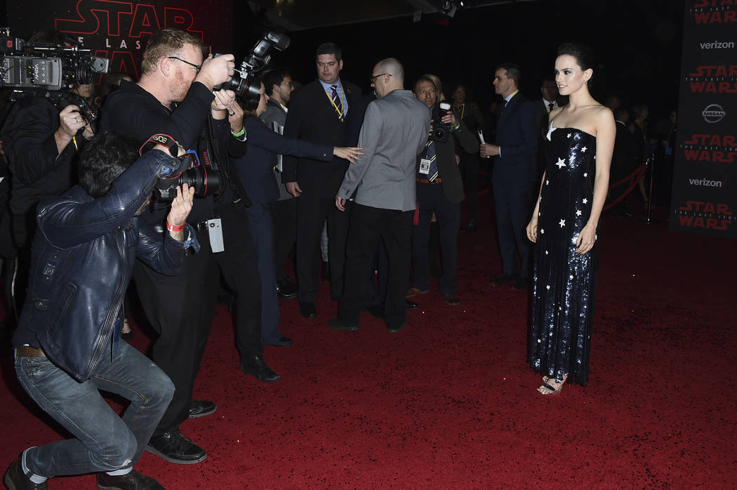 """Daisy Ridley arrives at the Los Angeles premiere of """"Star Wars: The Last Jedi"""" at the Shrine Auditorium on Saturday, Dec. 9, 2017, in Los Angeles. (Photo by Jordan Strauss/Invisi ..."""