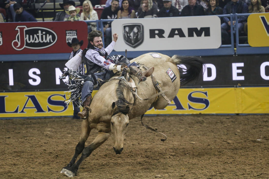 Wyatt Denny of Minden, Nev. rides Assault in the bareback riding event during the third night of the 59th Wrangler National Finals Rodeo at the Thomas & Mack Center in Las Vegas, Saturday, Dec ...