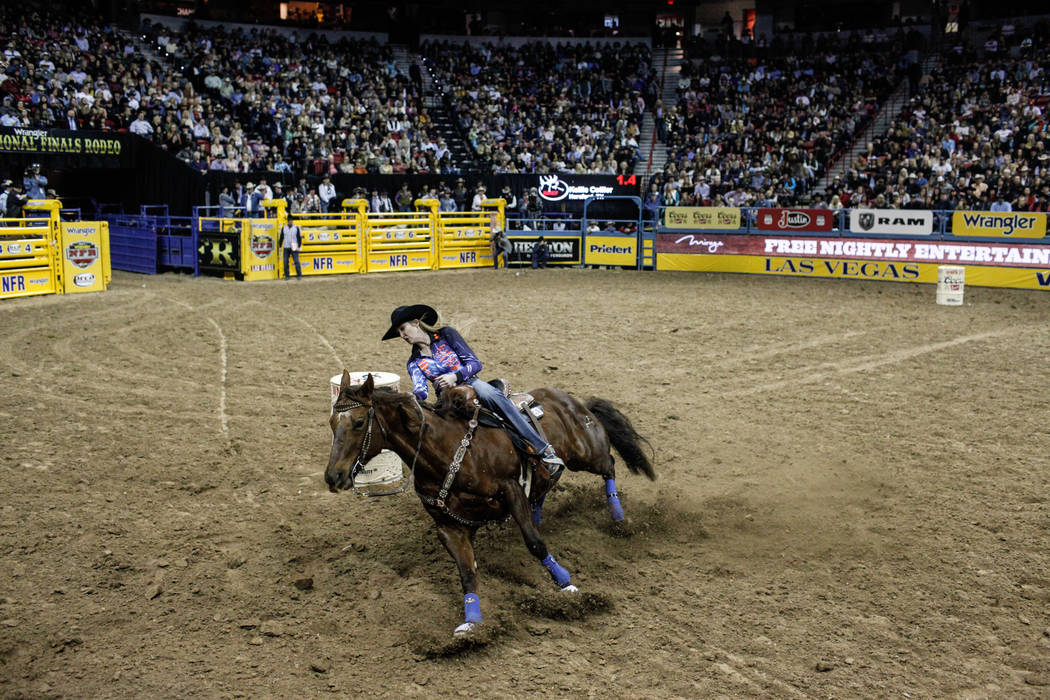 Kellie Collier of Hereford, Texas rides in the barrel racing event during the third night of the 59th Wrangler National Finals Rodeo at the Thomas & Mack Center in Las Vegas, Saturday, Dec. 9, ...