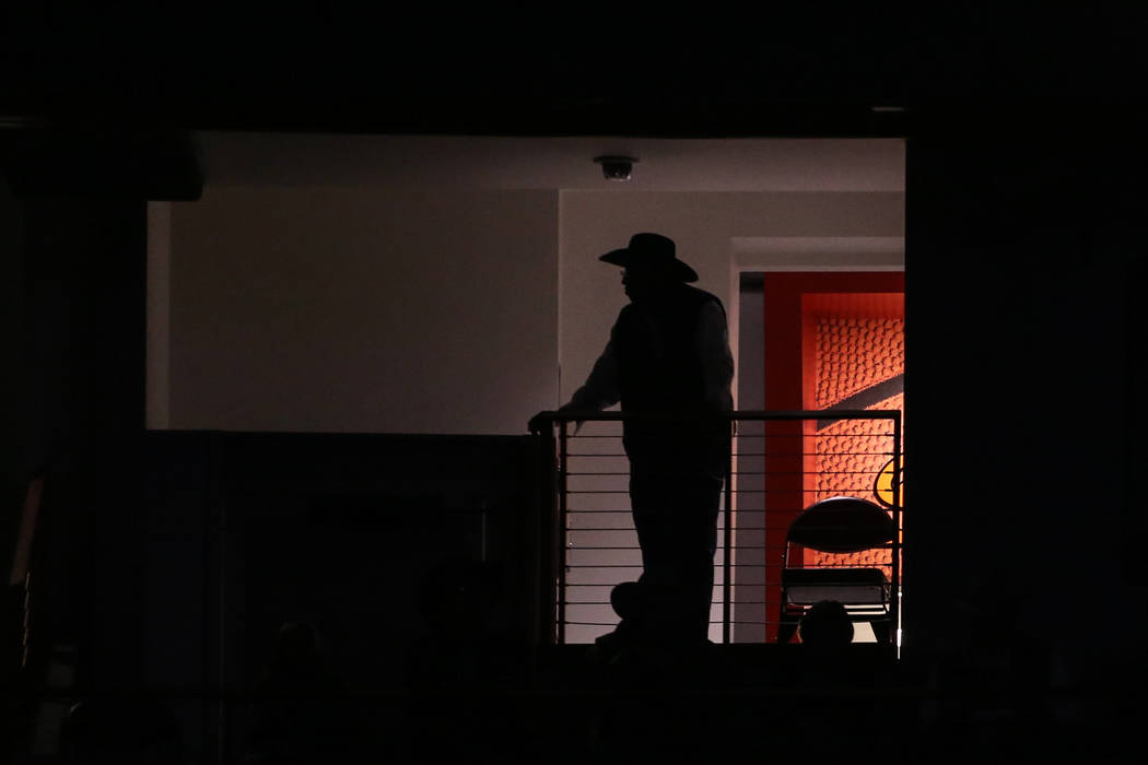 A person watches the third night of the 59th Wrangler National Finals Rodeo at the Thomas & Mack Center in Las Vegas, Saturday, Dec. 9, 2017. Joel Angel Juarez Las Vegas Review-Journal @jajuar ...