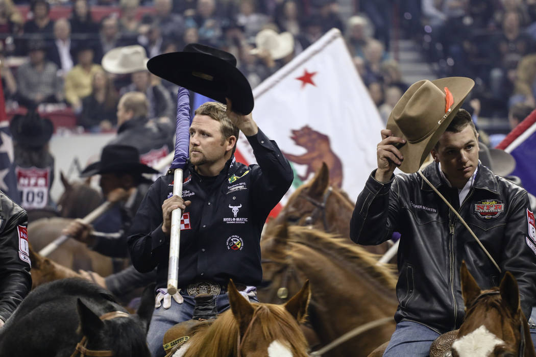 Riders make their way into the arena during the third night of the 59th Wrangler National Finals Rodeo at the Thomas & Mack Center in Las Vegas, Saturday, Dec. 9, 2017. Joel Angel Juarez Las V ...
