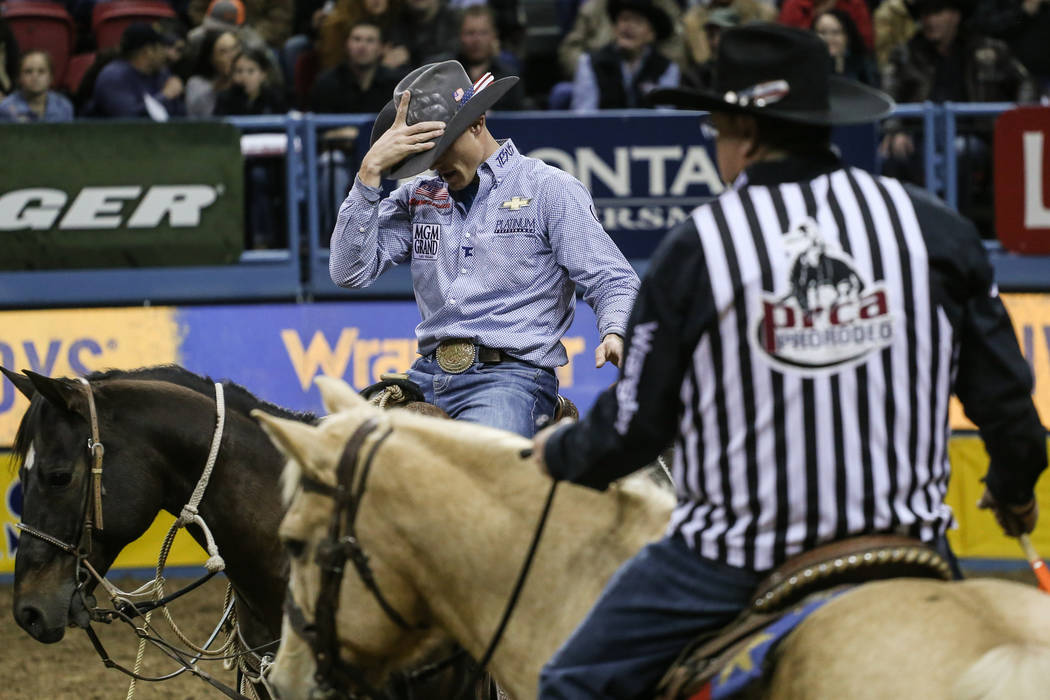 Tuf Cooper of Weatherford, Texas reacts the tie-down roping event during the third night of the 59th Wrangler National Finals Rodeo at the Thomas & Mack Center in Las Vegas, Saturday, Dec. 9,  ...