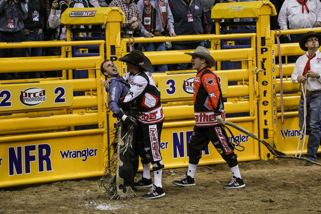 Sage Kimzey of Strong City, Okla. reacts after riding Nose Bender in the bull riding event during the third night of the 59th Wrangler National Finals Rodeo at the Thomas & Mack Center in Las  ...