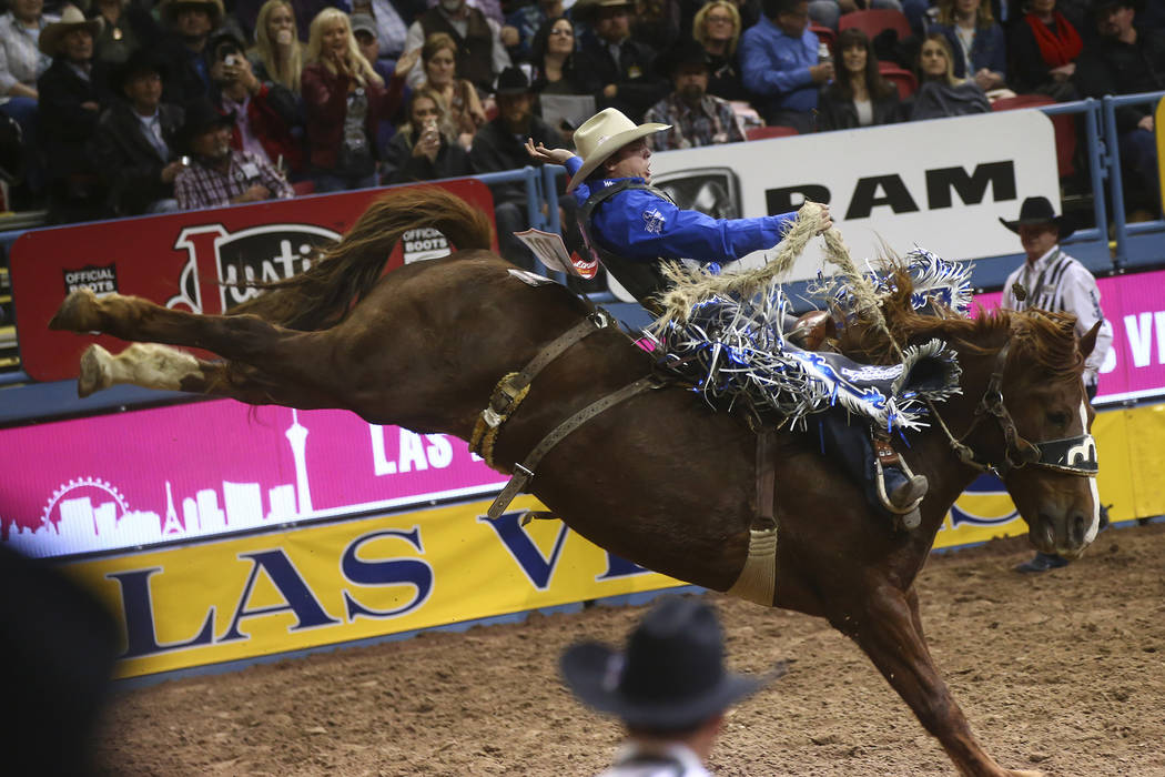 Jesse Wright competes in the saddle bronc riding event during the second night of the National Finals Rodeo at the Thomas & Mack Center in Las Vegas on Friday, Dec. 8, 2017. (Chase Stevens/Las ...
