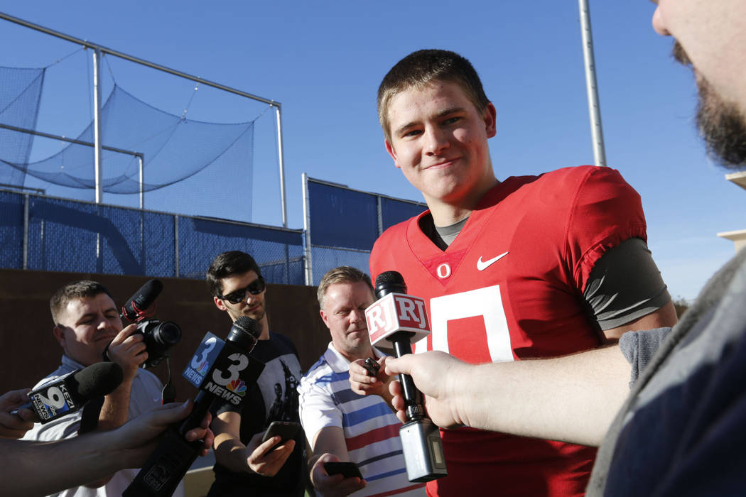Oregon Ducks quarterback Justin Herbert (10) speaks to reporter before a football practice at Bishop Gorman High School in Las Vegas, Wednesday, Dec. 13, 2017. Oregon Ducks and Boise State Broncos ...